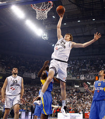 Partizan Belgrade's Vesely goes for the basket against Maccabi Electra's Lasme during their men's basketball Euroleague quarterfinal playoffs game in Belgrade
