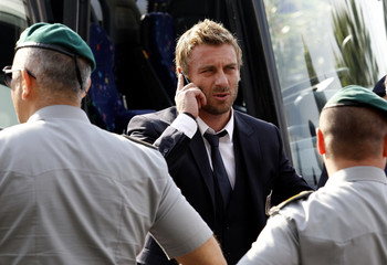 Italy's national soccer team player De Rossi talks on his mobile phone upon arrival at Fiumicino international airport in Rome
