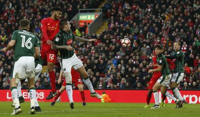 Liverpool's Joe Gomez heads at goal
