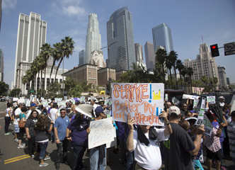Activists march during a protest demanding better wages for fast-food workers in Los Angeles