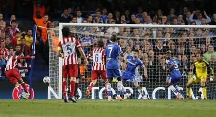 Atletico Madrid's Lopez scores a goal against Chelsea in Champion's League semi-final second leg soccer match in London