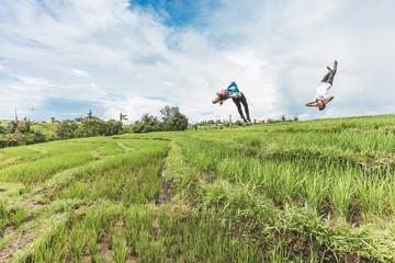 Freerunning in rice fields in Canggu, Bali