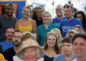 U.S. Democratic presidential nominee Hillary Clinton takes a picture with employees while visiting Raygun, a clothing store, in Des Moines
