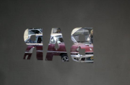A car on the street is seen from inside newly reopened Sloppy Joe's bar in Havana