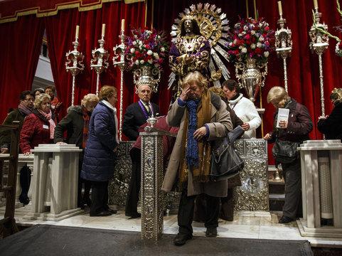 People stand in line to touch the icon of Jesus de Meninaceli at the Basilica of Jesus de Medinaceli in central Madrid