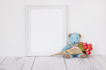 Stock photography white frame vintage painted wood table cute blue bear holding rose flower
