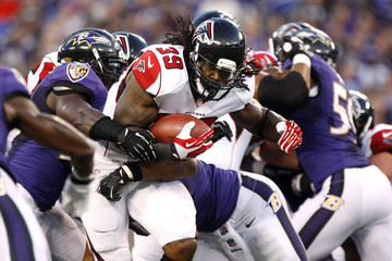 Falcons' Jackson runs the ball against the Ravens defense during the first half of their NFL pre-season football game in Baltimore