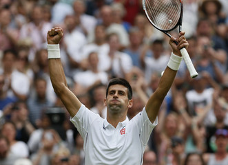 Novak Djokovic of Serbia reacts after defeating Andrey Golubev of Kazakhstan in their men's singles tennis match at the Wimbledon Tennis Championships, in London