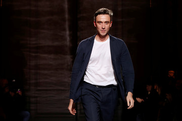 French designer Guillaume Henry appears at the end of his Spring/Summer 2017 women's ready-to-wear collection for fashion house Nina Ricci during Fashion Week in Paris