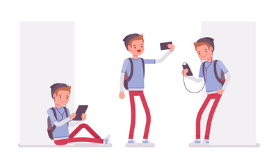 Teenager boy using different gadgets