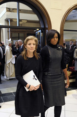 Caroline Kennedy Schlossberg  escorts first lady Michelle Obama at Shriver funeral in Maryland