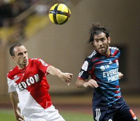Delgado of Olympique Lyon challenges Bonnart of AS Monaco during their French Ligue 1 soccer match in Monaco