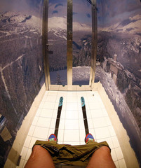 """The walls of a toilet are decorated with  mountain panorama wallpaper and skis on the floor at the """"Red Fox"""" restaurant in the winter sport resort of Rosa Khutor, a venue for the Sochi 2014 Winter Olympics near Sochi"""