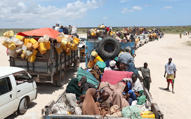 Internally displaced families board trucks as they travel back to their home regions from Ala-yasir camp closed by the al Shabaab militias in Lower Shabelle