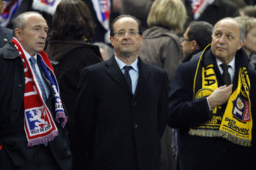 Francois Hollande Socialist party candidate for the 2012 French presidential election, socialist mayor of Lyon Collomb and former socialist prime minister Fabius attend the French Cup final soccer match at the Stade de France Stadium in Saint-Denis
