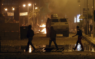 Protesters walk away from rubber bullets and teargas in Port Said city