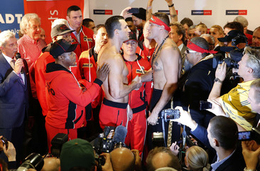 Ukrainian WBO, IBO and IBF heavy weight boxing world champion Klitschko and Polish boxing contender Wach shake hands after weigh-in in Hamburg