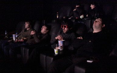 Young Chechens watch a film in a new 3D cinema in central Grozny