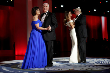 President Donald Trump with his wife Melania and Vice President Mike Pence with his wife Karen dance