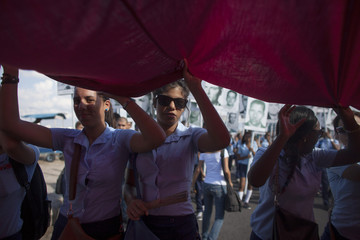 Students take part in a march in Havana