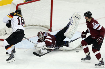 Latvia's goaltender Gudlevskis saves in front of Germany's Oppenheimer during the first period of their men's ice hockey World Championship group B game at Minsk Arena in Minsk