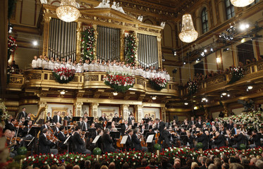 Jansons of Latvia conducts the Vienna Philharmonic Orchestra as the Vienna's Boys Choir perform during the traditional New Year's Concert in the Golden Hall of the Vienna Musikverein in Vienna