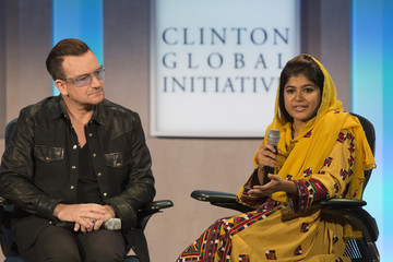 The lead singer of Irish rock band U2, Bono, listens as the founder of Giving Women Wings in Pakistan, Khalida Brohi, speaks at at the Clinton Global Initiative 2013 (CGI) in New York