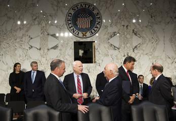 Senators McCain, Kaine and Cardin speak before before a Senate Foreign Relations Committee hearing in Washington