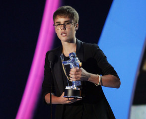 "Bieber accepts the award for best male video for ""U Smile"" at the 2011 MTV Video Music Awards in Los Angeles"