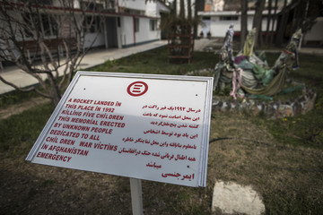 A memorial plaque dedicated to all child victims of war in Afghanistan stands at Emergency hospital in Kabul