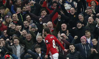 Manchester United's Juan Mata celebrates scoring their first goal