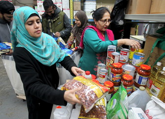 Uzma Anjum, Parveen Bhatta and Yasmin Shah sort and pack food donations destined for Syrian refugees in Lebanon's Bekaa Valley, at the Muslim Welfare Centre in Scarborough