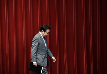 Prime Minister Yoshihiko Noda leaves a news conference room after announcing new cabinet members at a news conference at his official residence in Tokyo