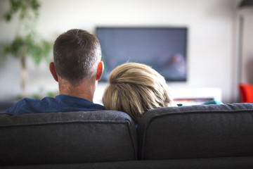 couple looking back in the living room at home