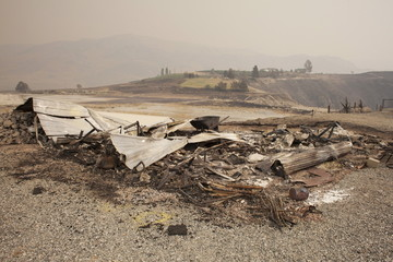 The remnants of a structure burnt by the Chelan Complex Fire is seen in Chelan, Washington