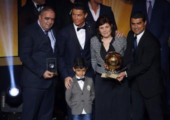 FIFA Ballon d'Or winner Ronaldo poses with his mother Maria Dolores dos Santos Aveiro and son Ronaldo Jr. after the FIFA Ballon d'Or 2014 soccer awards ceremony in Zurich