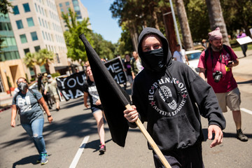 Anti-fascist counter-protestor parade through Sacramento after multiple people were stabbed during a clash between neo-Nazis holding a permitted rally and counter-protestors on Sunday at the state capitol in Sacramento.