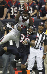 Atlanta Falcons wide receiver Julio Jones and Houston Texans cornerback Jason Allen keep their eye on the ball on an incomplete pass to the end zone.