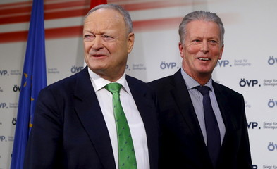 Former OeVP faction leader Khol and OeVP head Vice Chancellor Mitterlehner leave a news conference of his party, presenting him as their candidate in the 2016 Austrian presidential election in Vienna