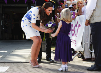Evie Farmer presents a posy to Britain's Catherine, Duchess of Cambridge, during her visit to Keech Hospice Care in Luton