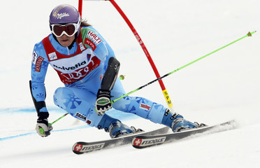 Maze of Slovenia clears a gate during the season's last giant slalom race at the women's Alpine Skiing World Cup finals in Lenzerheide