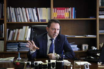 Greece's Finance Minister Stournaras speaks during an interview with Reuters in Athens