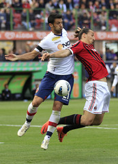 AC Milan's Ibrahimovic challenges Bologna's Cherubin during their Italian Serie A soccer match at Giuseppe Meazza stadium in Milan