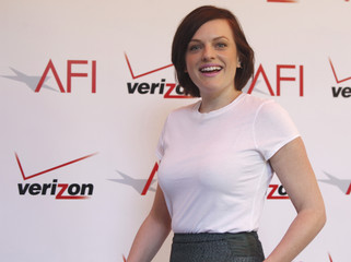 Actress Elisabeth Moss arrives at the AFI Awards 2013 in Beverly Hills