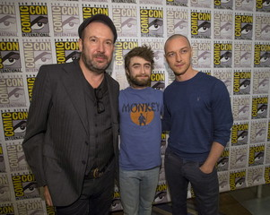 """Director of the movie McGuigan poses with cast members Radcliffe and McAvoy at a press line for """"Victor Frankenstein"""" during the 2015 Comic-Con International Convention in San Diego"""