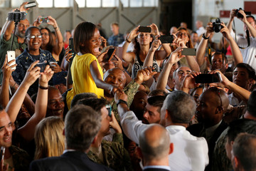Obama greets military families after delivering remarks to military personnel at Naval Station Rota in Rota, Spain