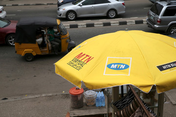 The logo of MTN telecommunication company is seen printed on an umbrella at a call point along a road in Lagos