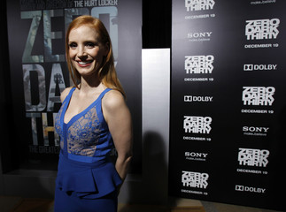 """Chastain poses at the premiere of """"Zero Dark Thirty""""at the Dolby theatre in Hollywood"""