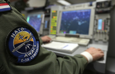 The patch of NATO AWACS (Airborne Warning and Control Systems) aircraft is seen attached to uniform of a controller during surveillance flight over Romania
