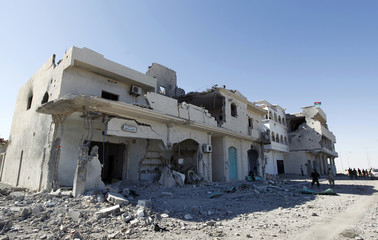 A view of a street in the devastated area where former Libyan leader Muammar was hiding out in Sirte